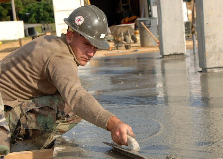 Why should you level a surface before installing a metal building?